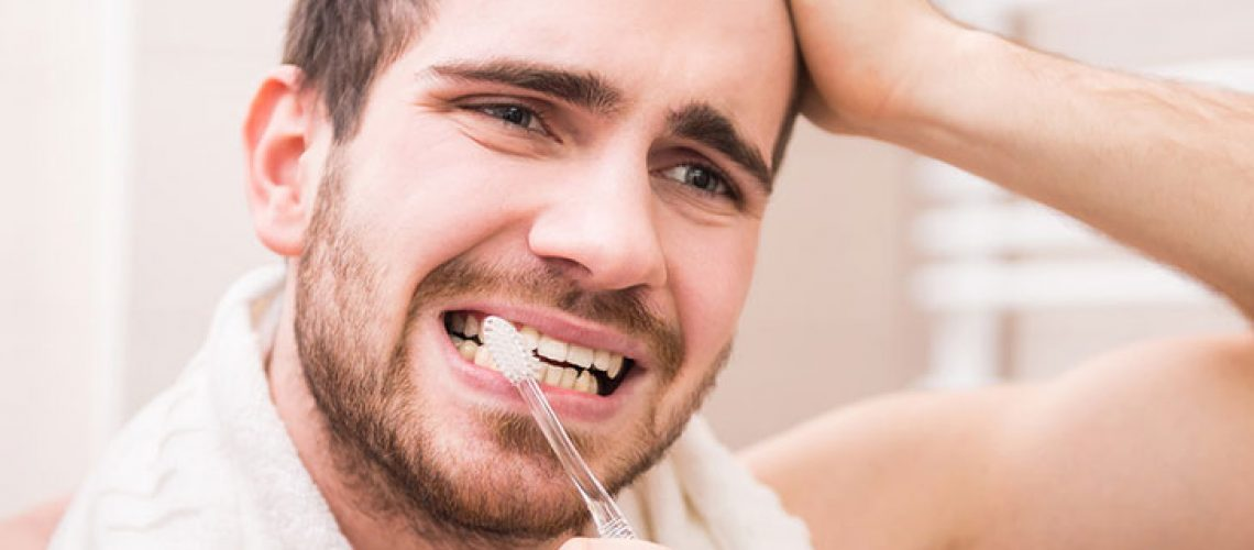 man-brushing-sensitive-teeth